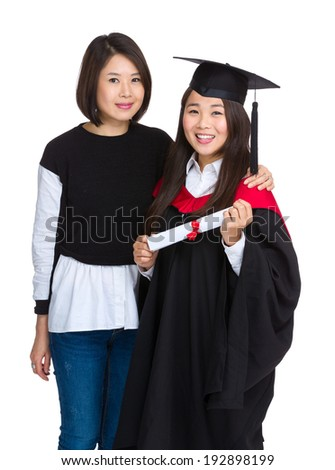 Graduation girl with older sister - stock photo
