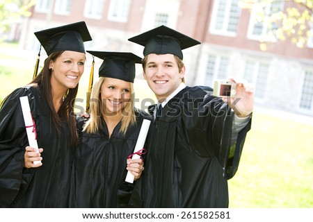 Graduation: Group of Friends Smile for Camera And Do Selfie - stock photo