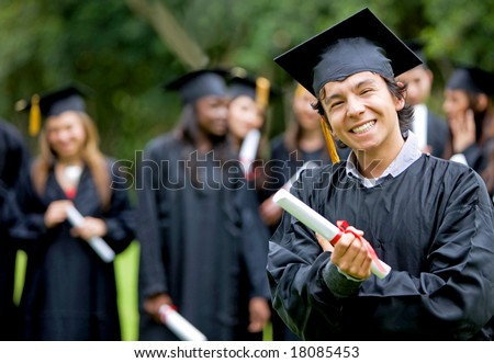 graduation group of students with a man leading smiling - stock photo