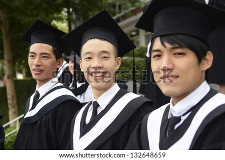 graduation group smiling on campus