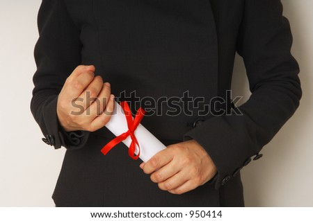 graduation - hands holding a certificate - stock photo