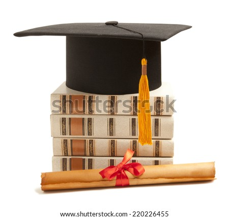 Graduation hat, book and diploma isolated on white - stock photo