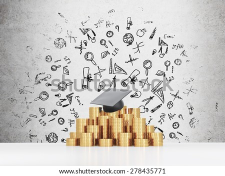 Graduation hat is laying on the coins pyramid. A concept of a high price for the university education. Education icons background. - stock photo