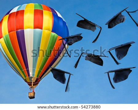 graduation hats airborne with hot air balloon - stock photo