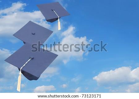 Graduation hats toss - stock photo