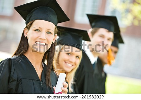 Graduation: Line of Smiling Graduates Look to Camera
