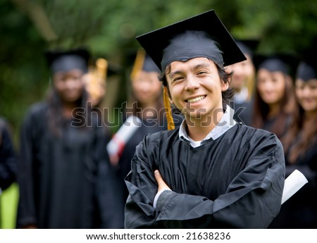 graduation man in front of a group of graduation students - stock photo