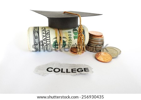 Graduation mortar board on cash with College paper scrap                                 - stock photo