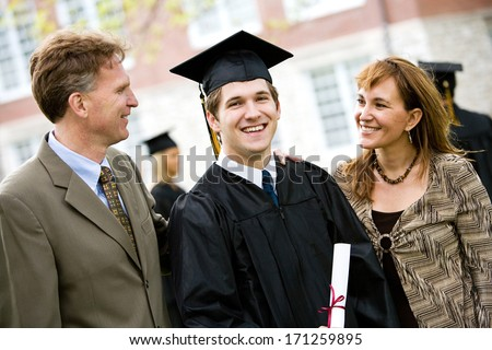 Graduation: Proud Male Student With Parents - stock photo