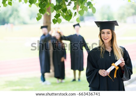 proud student stock images royalty images vectors  graduation student standing diploma friends behind