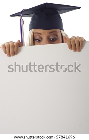 Graduation woman looking at copyspace below isolated over a white background - stock photo