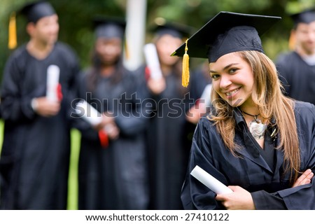 graduation woman smiling and looking happy outdoors