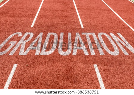 Graduation written on running track
