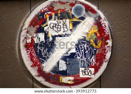 Graffiti and tags on a no parking sign - stock photo