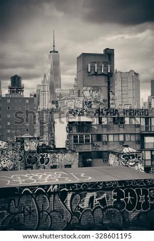 Graffiti and urban buildings in downtown Manhattan. - stock photo