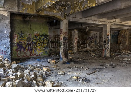 Graffiti artist illegally abandoned in a ruined building. Beautiful street art. Urban contemporary culture. In dark colors. selective Focus  - stock photo