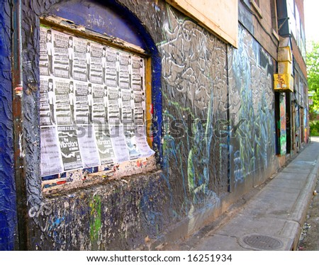 Graffiti covered alleyway - stock photo