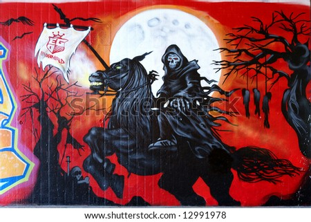 Graffiti: Death riding on a horse at full-moon - stock photo