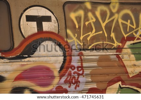 Graffiti decorating an abandoned public transit metro car in Boston, Massachusetts