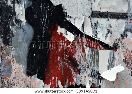 graffiti detail and torn peeling posters background - stock photo