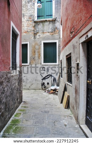 Graffiti down an old street in Venice, Italy - stock photo