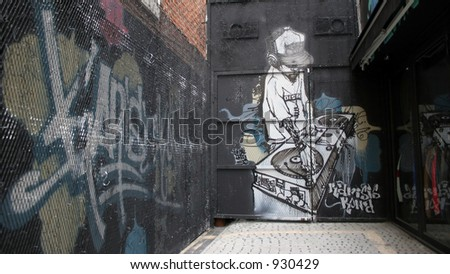 Graffiti of a DJ playing music on turntables