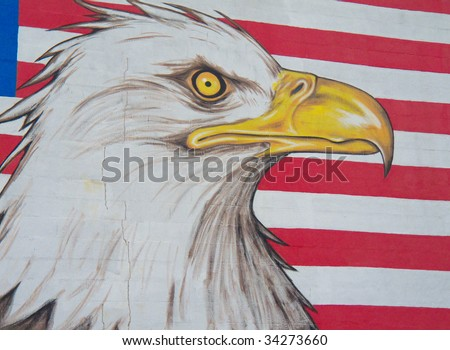 graffiti of an eagle with the american flag in the background - stock photo