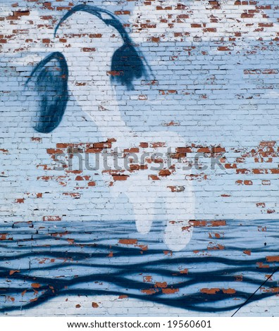 Graffiti of Whale on Brick Wall with Waves - stock photo
