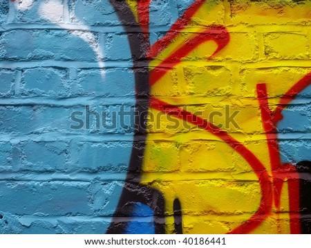 Graffiti on a Brick Wall, Showing Abstract Detail - stock photo