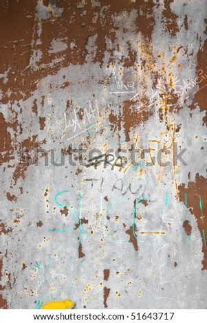 Graffiti on a rusty metal door - stock photo