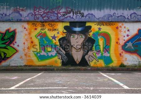 Graffiti on a wall in a public car park. - stock photo
