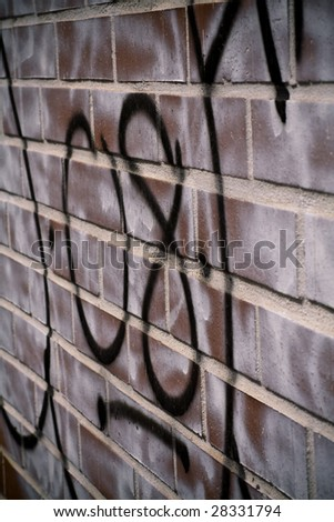 graffiti on brick - stock photo