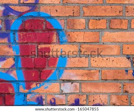 Graffiti on brick wall, background.  - stock photo