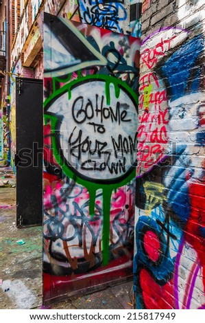 Graffiti on doors in Graffiti Alley, Baltimore, Maryland. - stock photo
