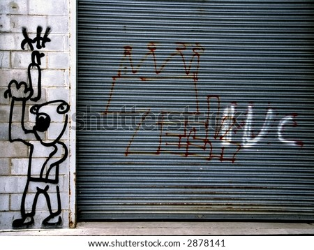 Graffiti on rusted steel door and concrete