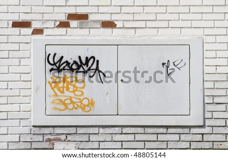Graffiti on the bricks wall, urban picture - stock photo