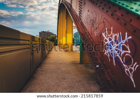 Graffiti on the side of the colorful Howard Street Bridge in Baltimore, Maryland. - stock photo