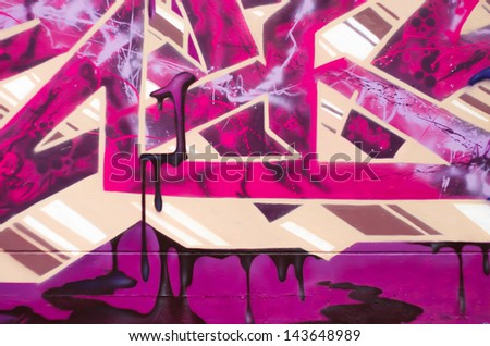 Graffiti over old dirty wall, urban painted with bright colorful - stock photo