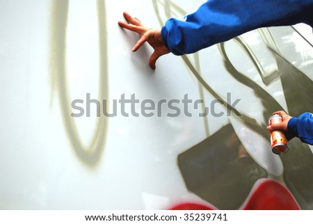 graffiti sprayer street artist with spray can - stock photo