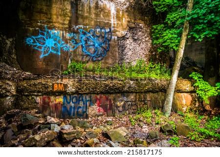 Graffiti under a railroad bridge in Lehigh Gorge State Park, Pennsylvania. - stock photo