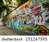 Graffiti Wall next to a historic building in Old Prague - stock