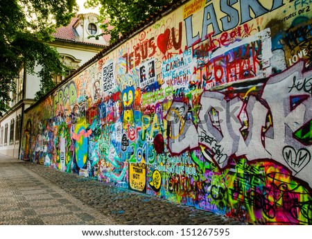 Graffiti Wall next to a historic building in Old Prague - stock photo