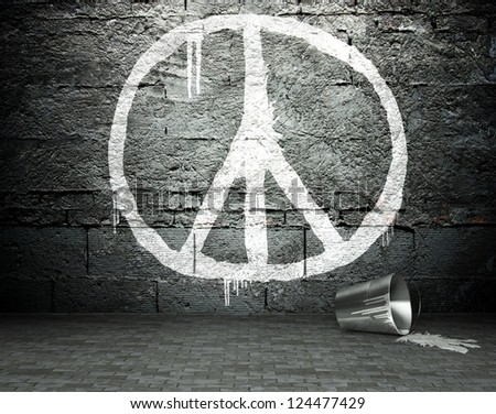 Graffiti wall with peace sign, street art background - stock photo