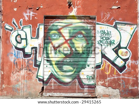 Graffitti Wall.Grunge background with graffiti - stock photo