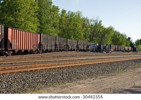 GRAFTON, OH - MAY 17: The economic downturn has forced railroads to store thousands of unused freight cars like these crammed onto a siding as seen on May 17, 2009 in Grafton, Ohio. - stock photo