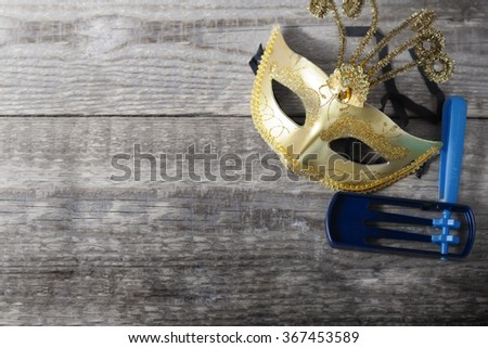 Gragger - noisemaker and carnival mask for Purim celebration (jewish holiday).  - stock photo