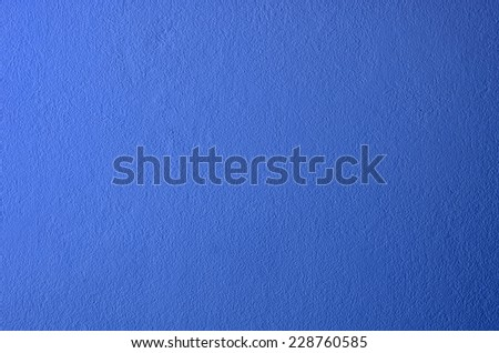 Grain blue paint wall background or texture  - stock photo