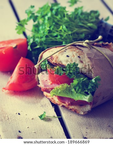 Grain bread sandwiches with ham, cheese and fresh vegetables / healthy food background - stock photo