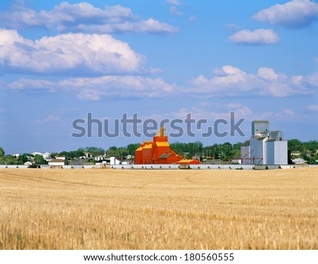 Grain Elevators and train cars - stock photo