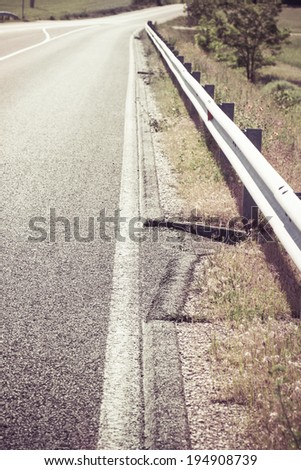 grain gutter in the road, next to pavement - colorized photo - stock photo